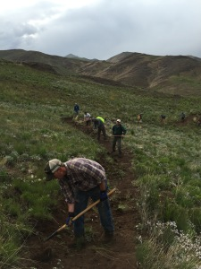 Zach Poff, Recreation Manger with the Ketchum Ranger Distict and other volunteers lending a hand last night.