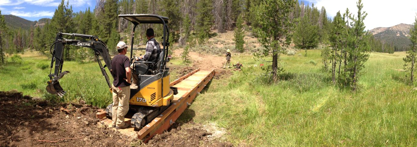 Trail building at Galena involves the use of machines and hand labor.